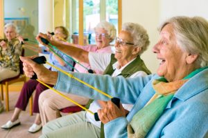 Elderly ladies exercising in a gym.